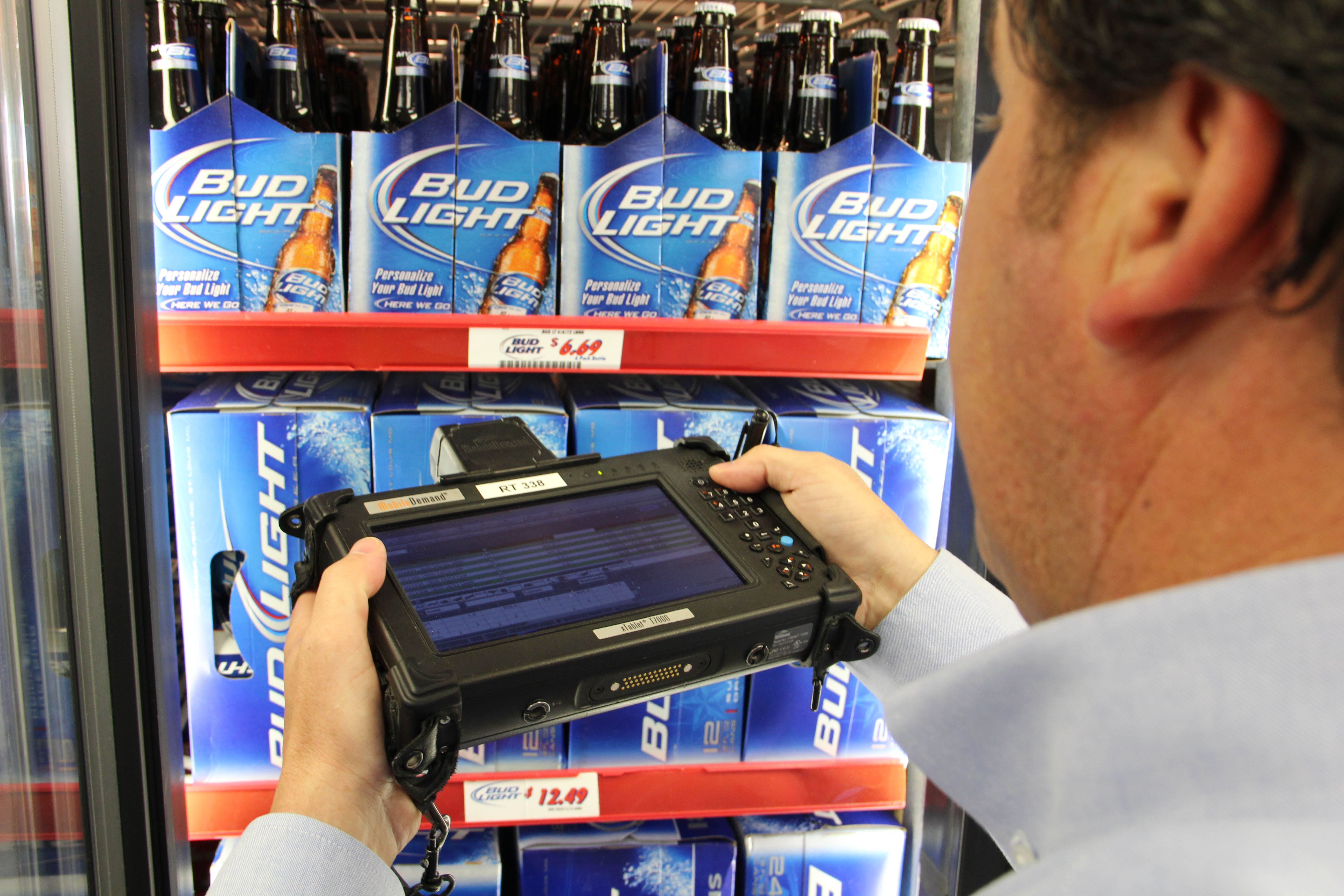 Ben E. Keith beer sales rep goes from a hot car to a convenience store cooler to take inventory at several stops throughout the day.