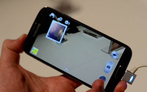 The Samsung Galaxy S4 can take photos with the front and rear camera at the same time.