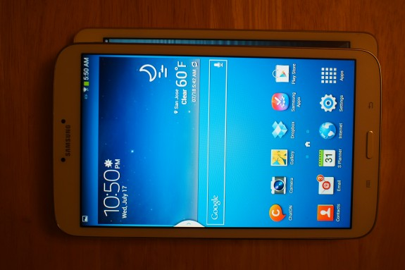 Size comparison: Galaxy Tab 3 8.0 stacked on top of the iPad mini, which is both shorter and more wide than the Samsung slate.