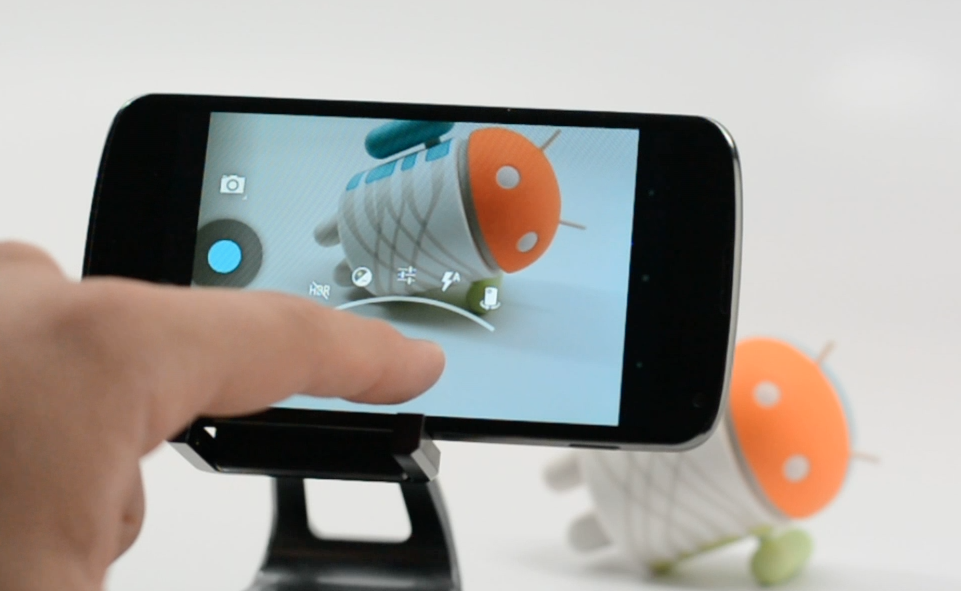 Android 4.3 adds a new camera app and the ability to take photos with a volume key.