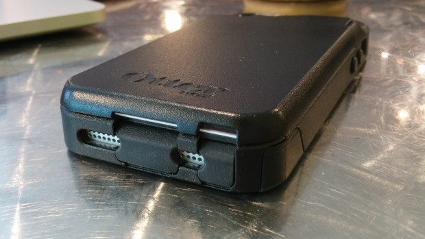 The ports are covered with the inner part of the case, with openings for the speakers.
