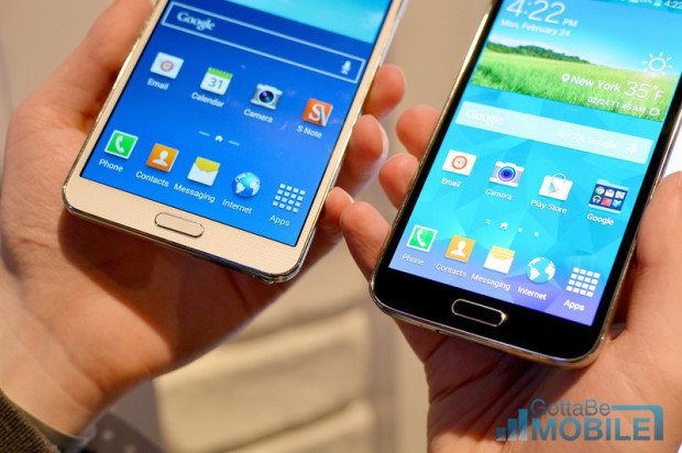 The new home button on the Galaxy S5 (right) is also a fingerprint reader.