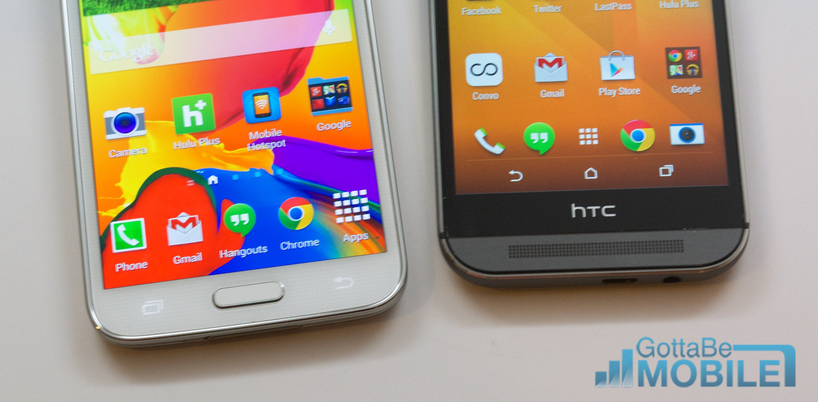 The Galaxy S5 features a fingerprint reader and capacitive buttons while the HTC One M8 features on screen buttons.