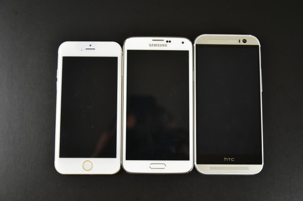 The iPhone 6 dummy vs. Galaxy S5 vs. HTC One M8.