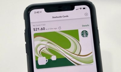 Starbucks gift card on iPhone screen.