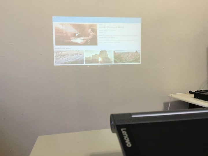 The Yoga Tab 3 Projector with overhead light on.