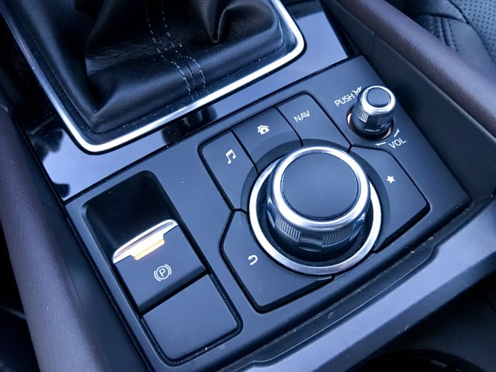 Touch the screen or use the knob and buttons to control the system.