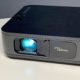 The Optoma LH150 is a very good portable projector that includes a battery.