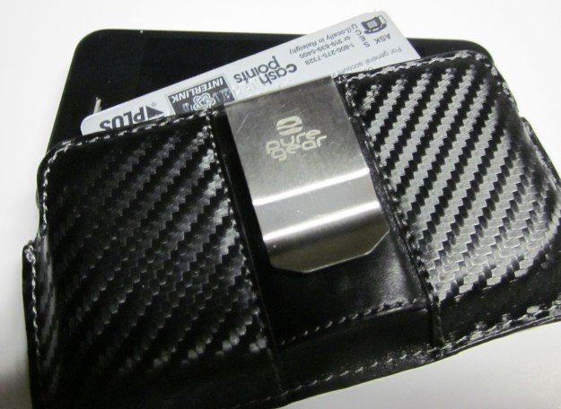 Pure Gear holds phone and has card/cash pocket
